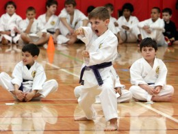 """Devon Buckley, participtaes in a karate tournament at Somers High School April 18, 2010. The tournament sponsored by Jim Smith Karate was to raise money for the Walsh family of Somers who lost their home in a fire last month. """"We just wanted to do something special for them and get the the rest of the community involved"""" said owner Jim Smith. Mike Walsh was on hand to watch the competition and expressed his thanks to the community """" They housed us, they fed us and they clothed us."""" ( Frank Becerra Jr. / The Journal News )"""